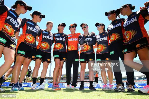 Lisa Keightley coach of the Scorchers and Elyse Villani address the team before warming up during the Women's Big Bash League match between the Perth...