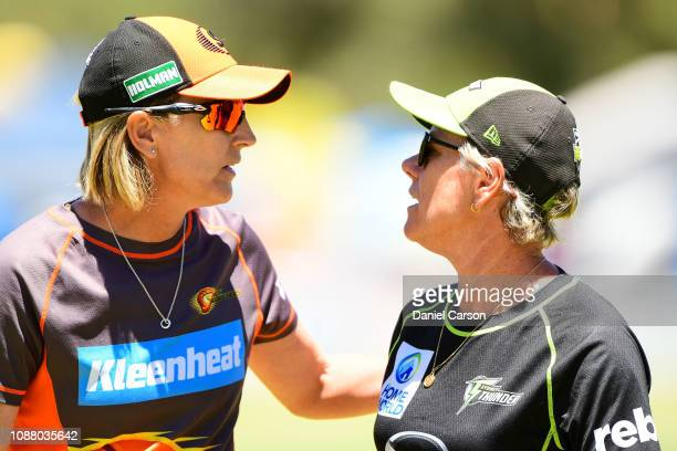 Lisa Keightley coach of The Scorchers shares a word with Joanne Broadbent coach of The Sydney Thunder during the Women's Big Bash League match...