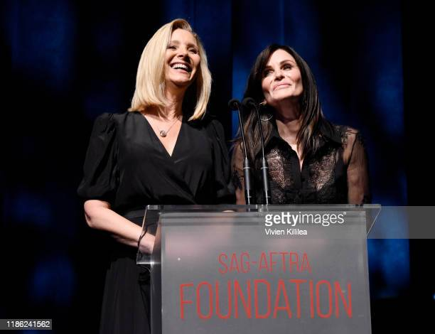 Lisa Kudrow and Courteney Cox speak onstage during SAG-AFTRA Foundation's 4th Annual Patron of the Artists Awards at Wallis Annenberg Center for the...
