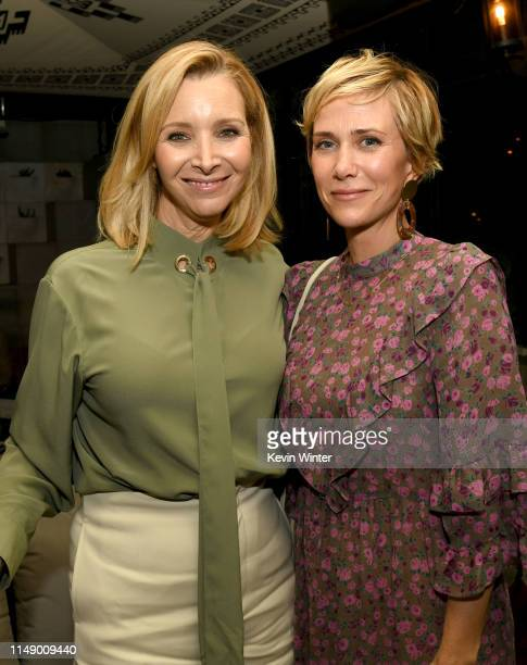 Lisa Kudrow and Kristen Wiig pose at the after party for the LA screening of Annapurna Pictures' Booksmart at the Ace Hotel on May 13 2019 in Los...