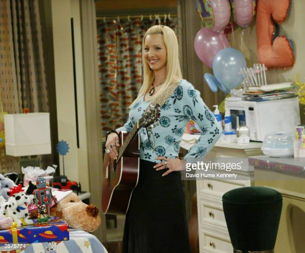 "Lisa Kudrow, who plays the ditzy Phoebe Buffay on the hit NBC series ""Friends"" performs during one of the series' last shows on the Warner Bros lot..."