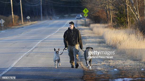 Lisa LaFlamme of Sebago walks down Pine Point Rd in Scarbrough with her dogs Sergeant left and Jackson Monday afternoon Dec 26 2011