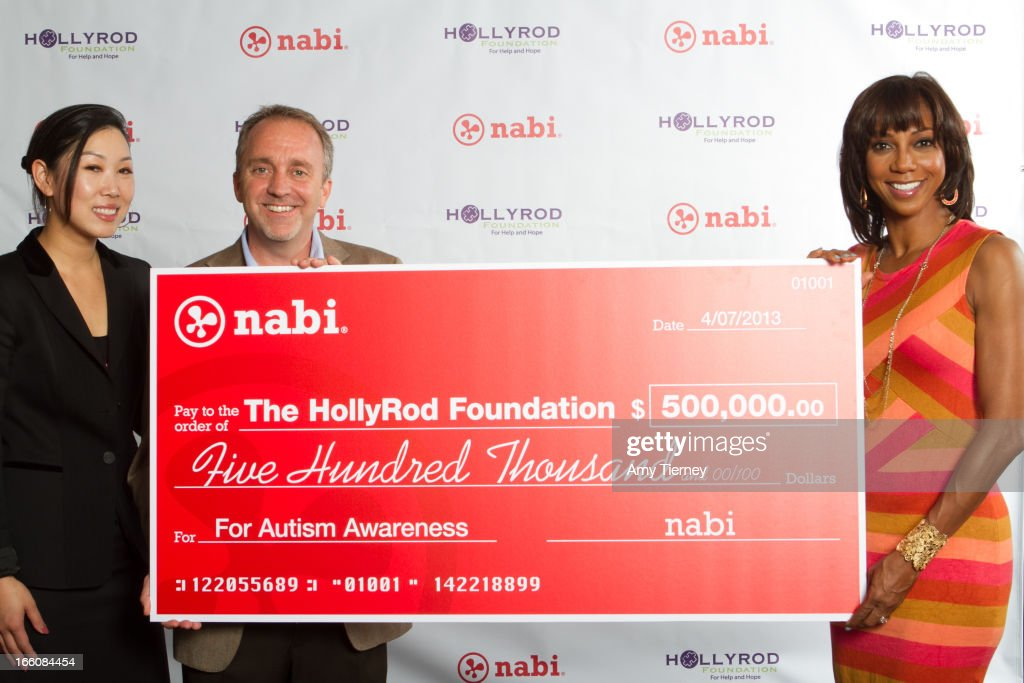 Lisa Lee, Director of Marketing and Communications, Fuhu Inc., Jim Mitchell, CEO of Fuhu Inc., and Holly Robinson Peete gather for a donation on behalf of nabi to the HollyRod Foundation to help families living with autism at Fuhu, Inc. on April 7, 2013 in Los Angeles, California.