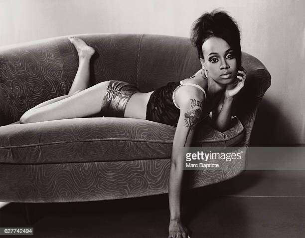 Lisa Left Eye Lopes of the RB group TLC reclines on a sofa