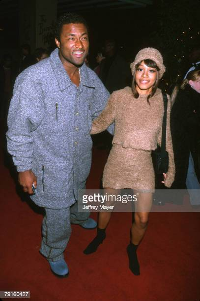 Lisa 'Left Eye' Lopes of TLC and Andre Rison at the Arista Records PreGrammy Party at the Beverly Hills Hotel Beverly Hills CA February 22nd 2000...