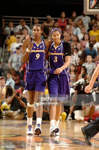 Lisa Leslie and Candace Parker of the Los Angeles Sparks celebrate a victory over the Phoenix Mercury on May 17 at US Airways Center in Phoenix...