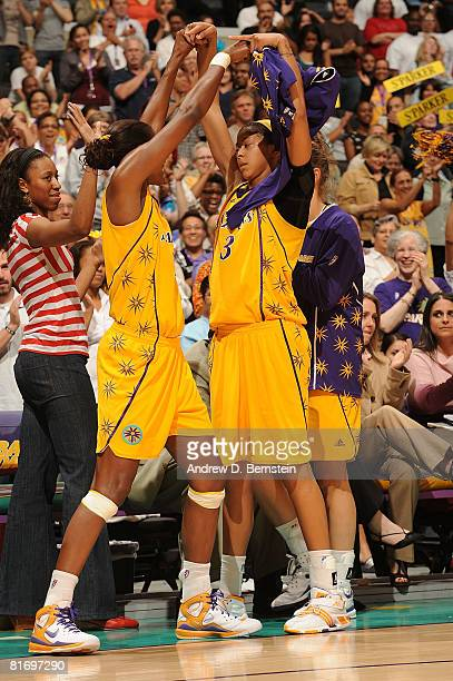 Lisa Leslie and Candace Parker of the Los Angeles Sparks celebrate Parker's dunk in the fourth quarter during the game against the Seattle Storm on...