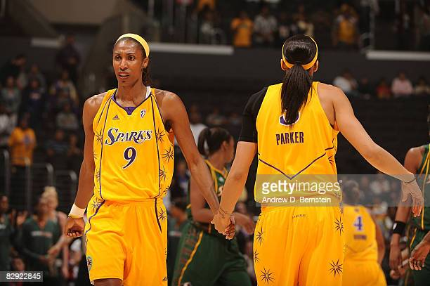 Lisa Leslie and Candace Parker of the Los Angeles Sparks congratulate each other after a play against the Seattle Storm during Game One of the...