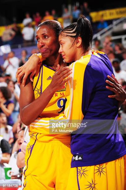 Lisa Leslie and Candace Parker of the Los Angeles Sparks hug after Leslie foulded out of the game against the Phoenix Mercury in Game Three of the...
