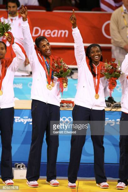Lisa Leslie and DeLisha Milton-Jones of the U.S. Women's Senior National Team celebrate after winning the gold medal against Australia at the Beijing...
