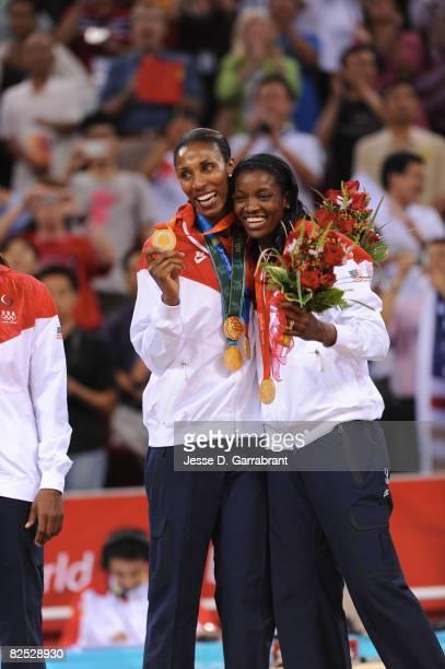 Lisa Leslie and DeLisha Milton-Jones of the U.S. Women's Senior National Team celebrate on the podium after winning the gold medal against Australia...