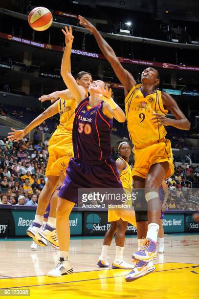 Lisa Leslie and Lindsay WisdomHylton of the Los Angeles Sparks blocks a shot against Nicole Ohlde of the Phoenix Mercury on August 27 2009 at Staples...