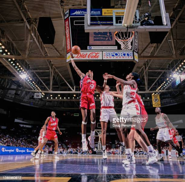 Lisa Leslie, Center for the United States makes a one handed lay up to the basket over the Cuban defense during the Pre Olympic International...