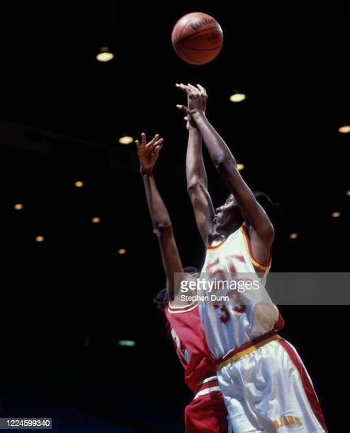 Lisa Leslie, Center for the University of Southern California Trojans challenges for the ball during the NCAA UCLA Tournament college basketballl...