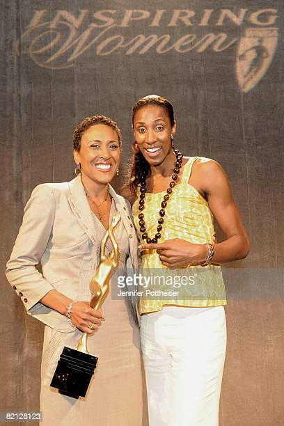 Lisa Leslie member of the Women's Basketball Senior National Team poses with Robin Roberts CoAnchor of ABC News' Good Morning America who was honored...