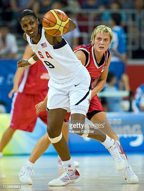Lisa Leslie of team USA left pulls in a loose ball in front of the Czech Republic's Hana Machova in the opening round of basketball on Saturday...