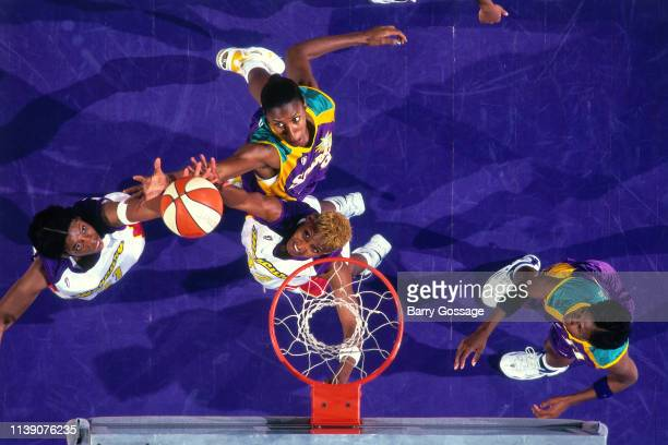 Lisa Leslie of the Los Angeles Sparks and Bridget Pettis of the Phoenix Mercury go for a rebound during the game on July 25 1997 at America West...