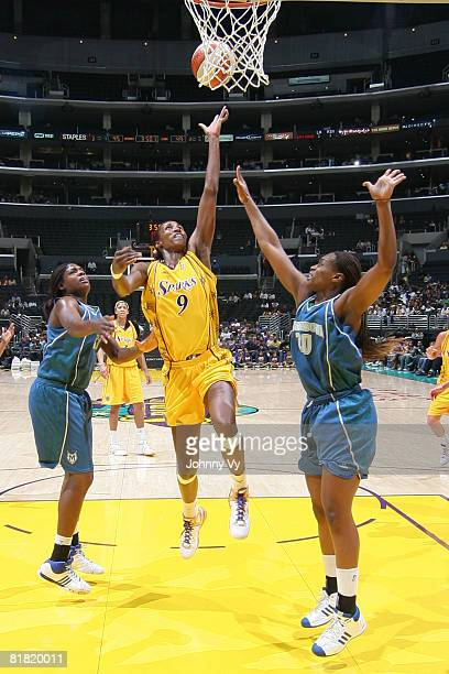Lisa Leslie of the Los Angeles Sparks attempts a shot against Charde Houston of the Minnesota Lynx during their game on July 3 2008 at Staples Center...