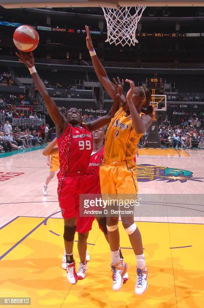 Lisa Leslie of the Los Angeles Sparks attempts to block a shot from Hamchetou MaigaBa of the Houston Comets at Staples Center July 9 2008 in Los...