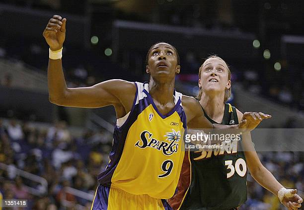 Lisa Leslie of the Los Angeles Sparks battles for position against Kate Starbird of the Seattle Storm in game two of the Western Conference...
