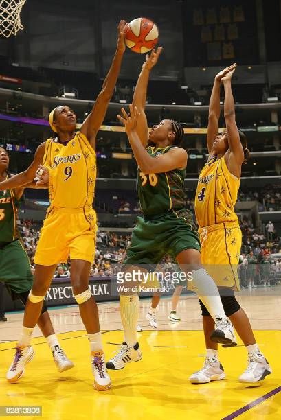 Lisa Leslie of the Los Angeles Sparks blocks a shot from Tanisha Wright of the Seattle Storm on September 14 2008 at Staples Center in Los Angeles...