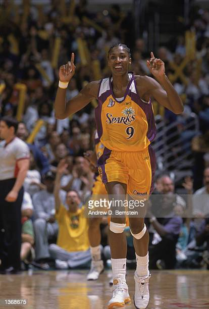 Lisa Leslie of the Los Angeles Sparks celebrates as she runs down the court during Game 2 of the 2002 WNBA Finals against the New York Liberty on...