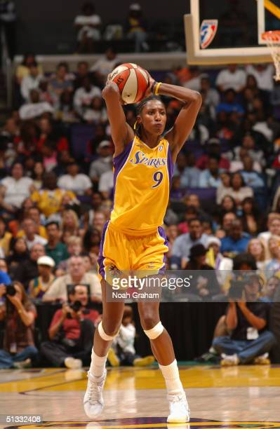 Lisa Leslie of the Los Angeles Sparks controls the ball against the Phoenix Mercury during the game at Staples Center on September 14 2004 in Los...