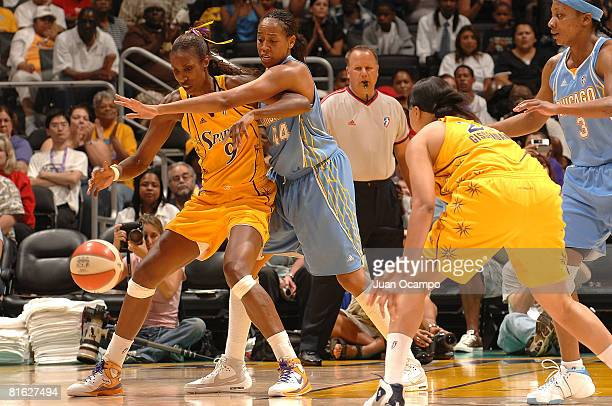 Lisa Leslie of the Los Angeles Sparks defends the ball as Chasity Melvin of the Chicago Sky reaches in during the game on June 18 2008 at Staples...