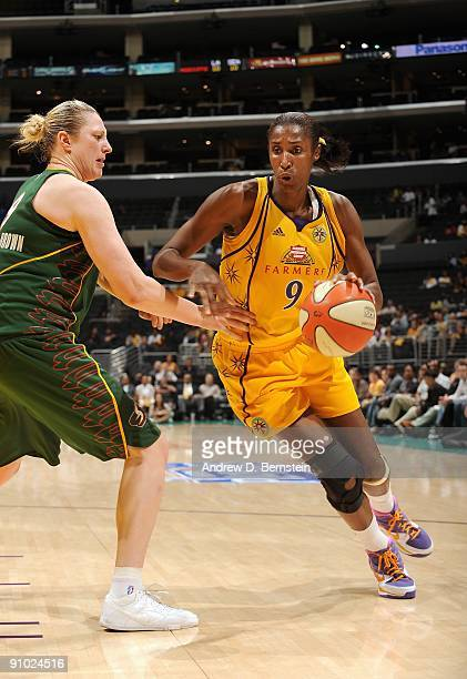 Lisa Leslie of the Los Angeles Sparks drives against Suzy BatkovicBrown of the Seattle Storm in Game One of the Western Conference Semifinals during...