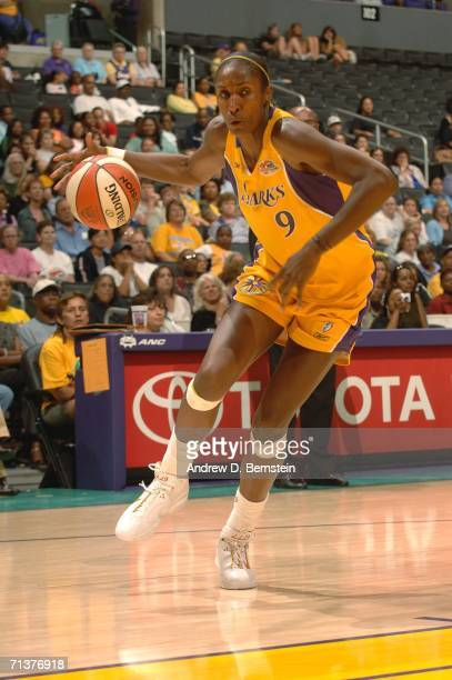 Lisa Leslie of the Los Angeles Sparks drives against the Houston Comets at the Staples Center July 5 2006 in Los Angeles California NOTE TO USER User...