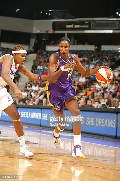 Lisa Leslie of the Los Angeles Sparks drives around Rebekkah Brunson of the Sacramento Monarchs during game one of the 2006 WNBA Western Conference...