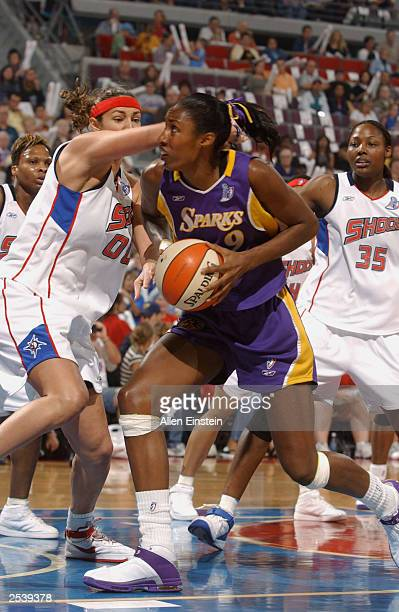 Lisa Leslie of the Los Angeles Sparks drives past Ruth Riley of the Detroit Shock during game three of the 2003 WNBA Finals at the Palace of Auburn...