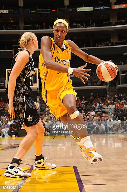 Lisa Leslie of the Los Angeles Sparks drives the ball against Ann Wauters of the San Antonio Stars during the game on August 30 2008 at Staples...
