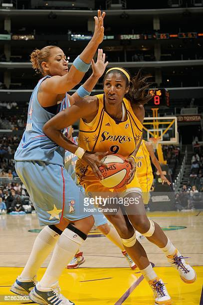 Lisa Leslie of the Los Angeles Sparks drives the ball against Erika Desouza the Atlanta Dream during the WNBA game on September 11 2008 at Staples...