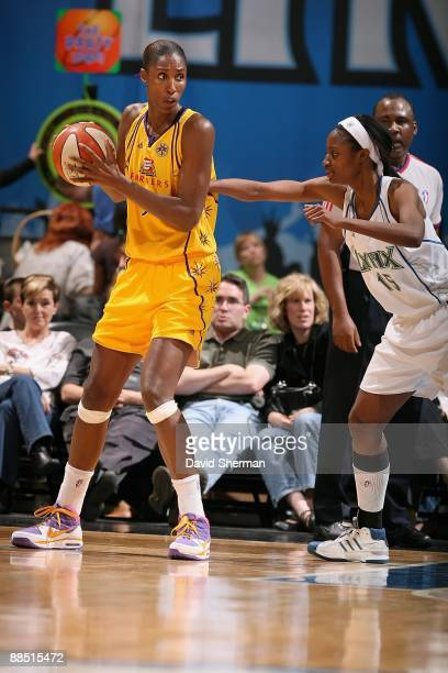 Lisa Leslie of the Los Angeles Sparks drives the ball against LaToya Pringle of the Minnesota Lynx during the WNBA game on June 10 2009 at Target...