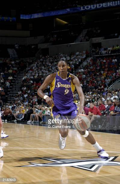 Lisa Leslie of the Los Angeles Sparks drives to the basket against the San Antonio Silver Stars during the WNBA game at SBC Center on June 26 2003 in...