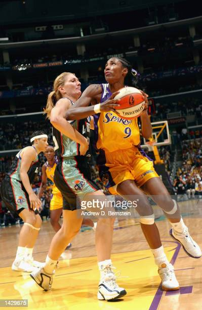 Lisa Leslie of the Los Angeles Sparks drives to the basket past Sue Wicks of the New York Liberty during Game two of the 2002 WNBA Finals on August...