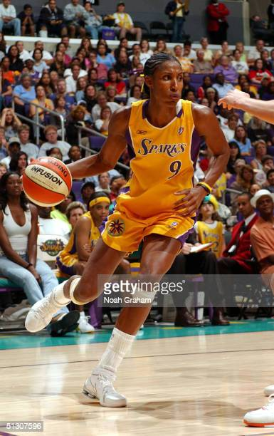 Lisa Leslie of the Los Angeles Sparks drives to the hoop against the Phoenix Mercury during the second half of action at Staples Center on September...