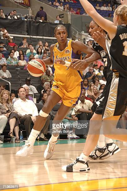 Lisa Leslie of the Los Angeles Sparks drives to the hoop against the San Antonio Silver Stars at the Staples Center on July 3 2006 in Los Angeles...