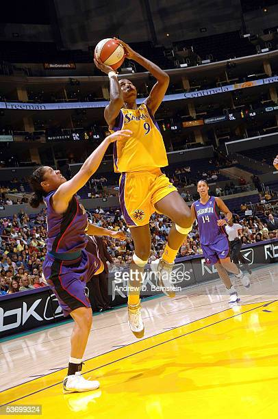 Lisa Leslie of the Los Angeles Sparks drives to the hoop past Kara Lawson of the Sacramento Monarchs in Game One of the Western Conference Semis...