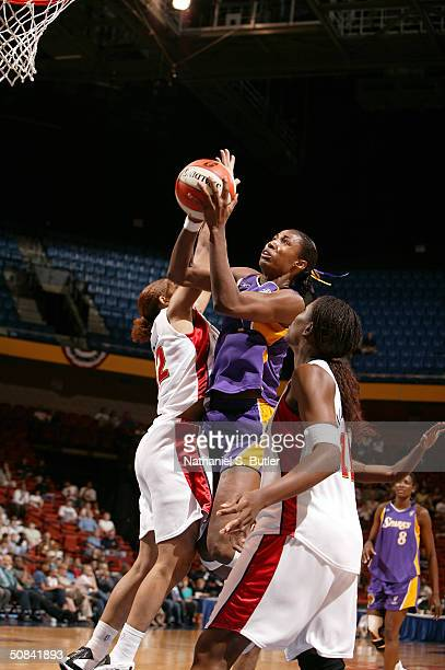 Lisa Leslie of the Los Angeles Sparks goes against Nykesha Sales of the Connecticut Sun on May 13 2004 at Mohegan Sun in Uncasville Connecticut NOTE...