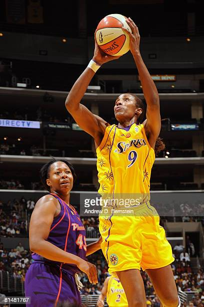 Lisa Leslie of the Los Angeles Sparks goes to the basket against Le'coe Willingham of the Phoenix Mercury on June 6 2008 at Staples Center in Los...