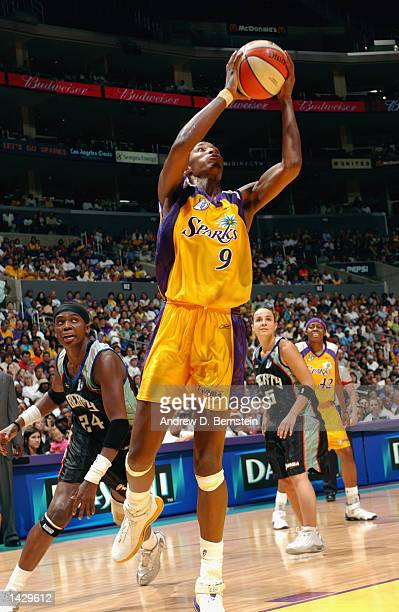 Lisa Leslie of the Los Angeles Sparks goes to the basket past Tari Phillips of the New York Liberty during Game two of the 2002 WNBA Finals on August...