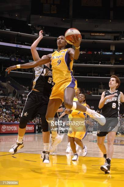 Lisa Leslie of the Los Angeles Sparks goes to the hoop against Kendra Wecker of the San Antonio Silver Stars during their game at the Staples Center...