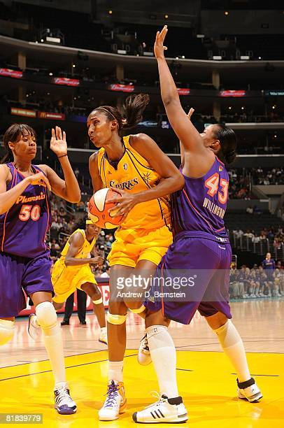 Lisa Leslie of the Los Angeles Sparks goes up for a shot as Tangela Smith and Le'Coe Willingham of the Phoenix Mercury defend on July 6 2008 at...