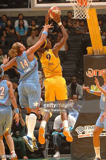 Lisa Leslie of the Los Angeles Sparks goes up for two points against Erika Desouza of the Atlanta Dream on September 11, 2008 at Staples Center in...