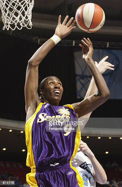 Lisa Leslie of the Los Angeles Sparks grabs a rebound during the WNBA game against the Orlando Miracle at TD Waterhouse Centre in Orlando Florida on...