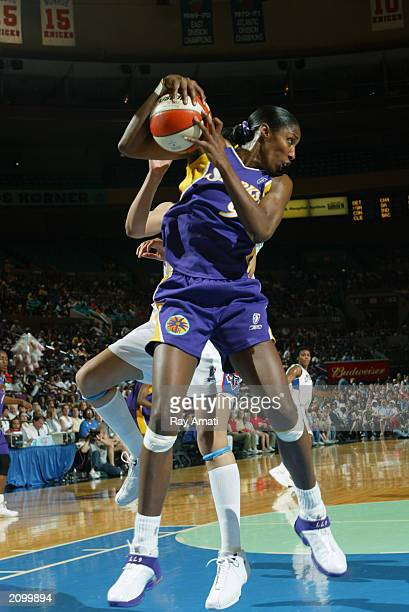 Lisa Leslie of the Los Angeles Sparks grabs the rebound during the WNBA game against the New York Liberty at Madison Square Garden on June 14 2003 in...