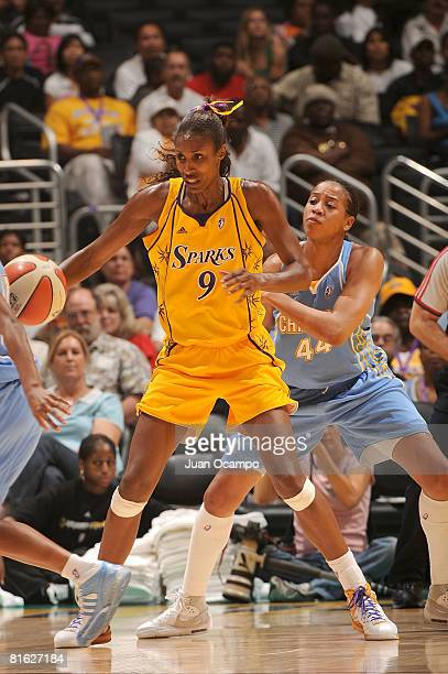 Lisa Leslie of the Los Angeles Sparks handles the ball during the game against Chasity Melvin of the Chicago Sky on June 18 2008 at Staples Center in...