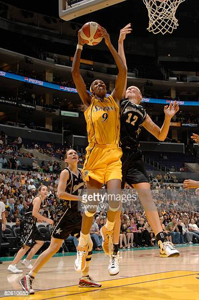 Lisa Leslie of the Los Angeles Sparks has her shot contested by Ann Wauters of the San Antonio Silver Stars during their game on August 30 2008 at...